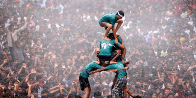 Hindu devotees form a human pyramid during the 'Dahi-handi' (curd pot) festival to celebrate Janmashtami...