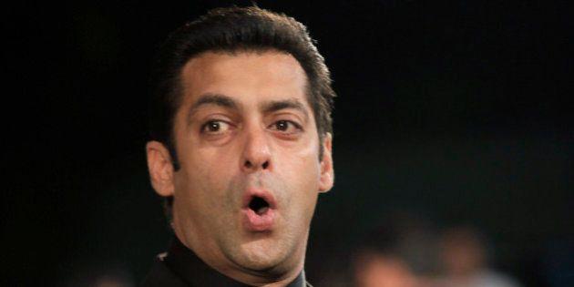 Bollywood actor Salman Khan speaks on the green carpet for the International Indian Film Academy (IIFA)...