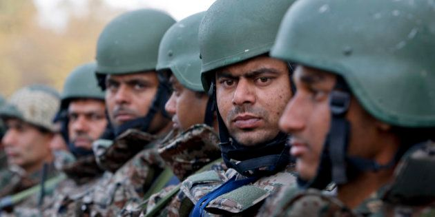 Indian army soldiers stand at the Indian air force base in Pathankot, India, Tuesday, Jan.5, 2016. Indian...