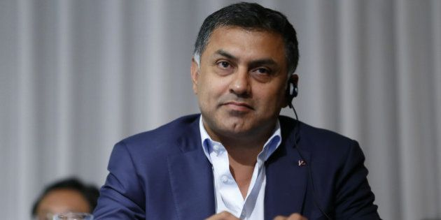 Nikesh Arora, president and chief operating officer of SoftBank Group Corp., looks on during a news conference...