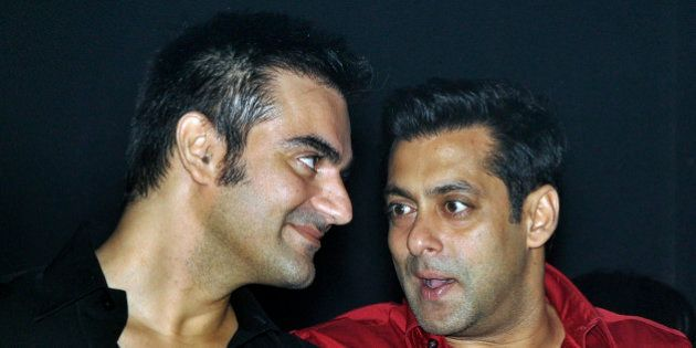 Indian Bollywood actor Salman Khan (R) speaks with his brother Arbaaz at the unveiling of 'Friday Moviez',...