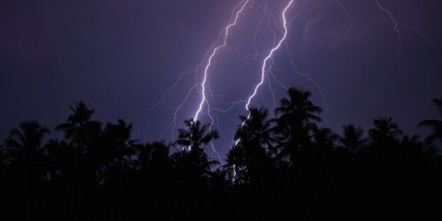 Twin lightning over the trees captured from Cochin, Kerala,