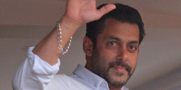 Bollywood actor Salman Khan greets fans from the balcony of his residence in Mumbai, India, Friday, May...