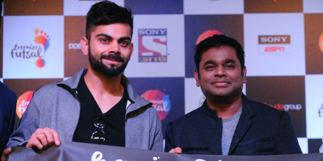 Indian cricketer VIrat Kohli(L) poses alongside Bollywood music director A.R.Rahman gestures during launch...