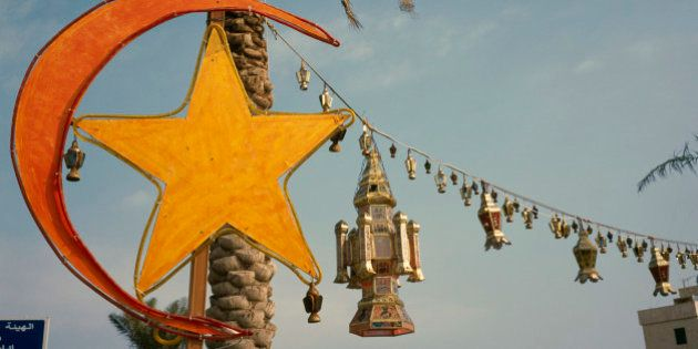 Kuwait, Kuwait City, Gulf Road. Crescent moon and lantern decorations for Eid at the end of
