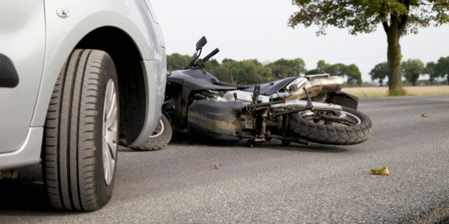 Motorbike Accident on the road with a
