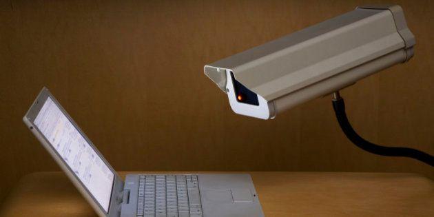Surveillance camera peering into laptop
