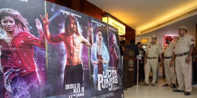 Indian Punjab Police stand in the lobby of a cinema hall as the controversial Bollywood movie 'Udta Punjab'...