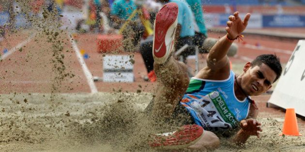 India's Ankit Sharma competes in a Men's Long Jump qualification during the Commonwealth Games at the...