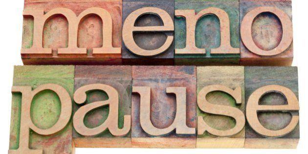 menopause - isolated word in vintage wood letterpress printing blocks stained by color