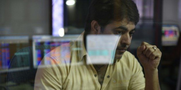 MUMBAI, INDIA - JUNE 25: A broker looks at his computer screen displaying the Sensex after Britain's...
