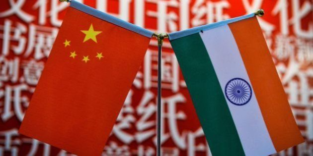 The national flags of India (R) and China are seen at the Delhi World Book fair at Pragati Maidan in...