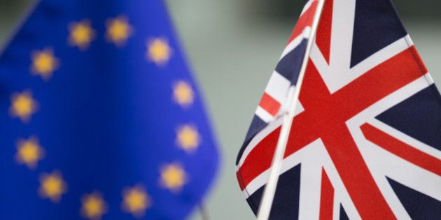 A European Union (EU) flag, left, and a British Union Flag, also know as a Union Jack, stand at a foreign...