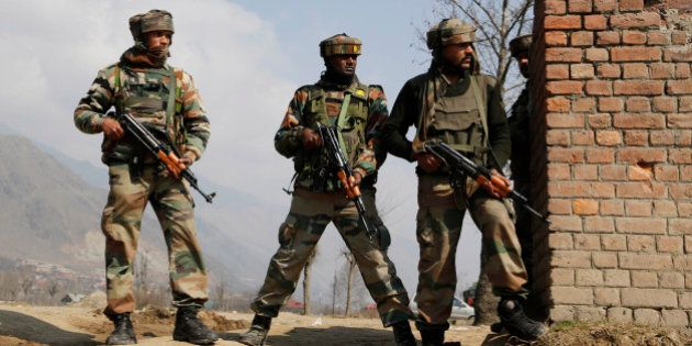 Indian Army soldiers take position during a gunbattle between Indian security forces and Kashmiri rebels...