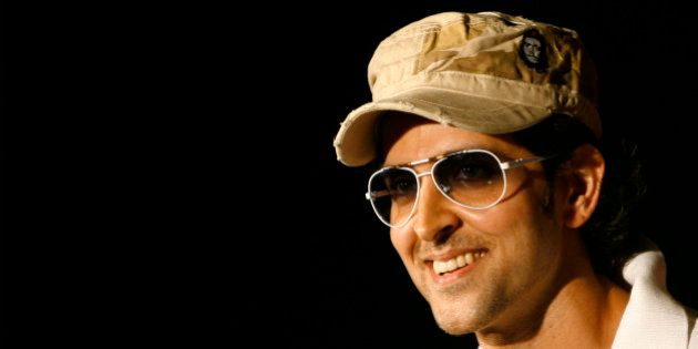 Bollywood actor Hrithik Roshan smiles during a promotional event of a beverage manufacturing company...