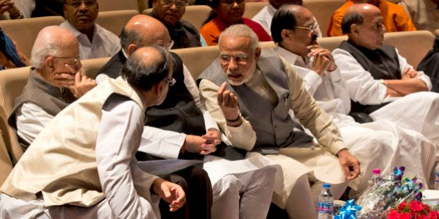 Indian Prime Minister Narendra Modi, third right, talks with Indian Finance Minister Arun Jaitley during...