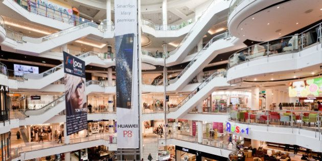 Customers browse retail floors at the Blue City shopping mall in Warsaw, Poland, on Wednesday, Nov. 4,...