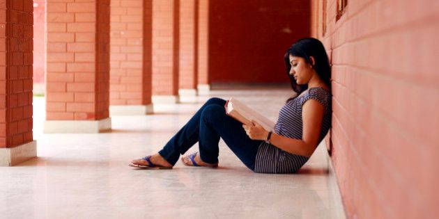 An Indian student reading a