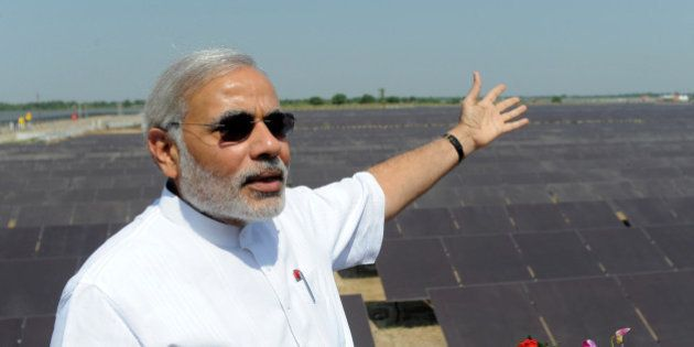 Chief Minister of the western Indian state of Gujarat Narendra Modi gestures as he poses at the inauguration...