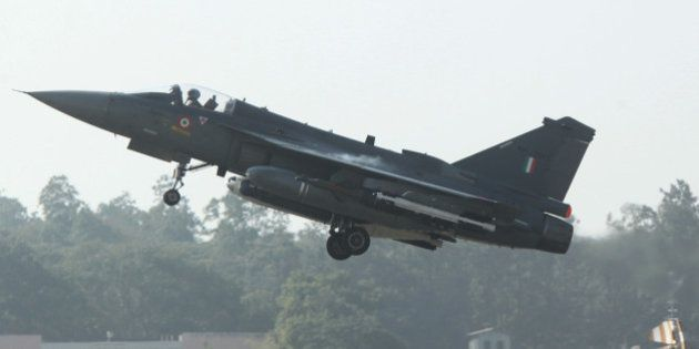 A HAL Tejas multirole light combat aircraft takes off for the type's initial operational clearance for...