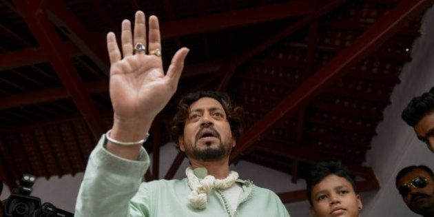 Indian actor Irrfan Khan speaks to the media next to his son Aayan at the Mahatma Gandhi Ashram in Ahmedabad...