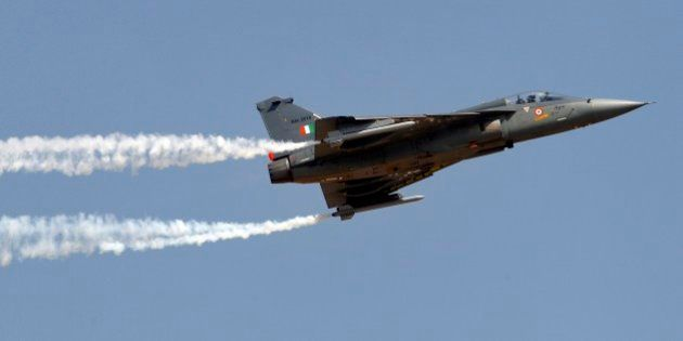 Tejas, an Indian Air Force light combat aircraft, leaves a trail of smoke as it flies on the final day...