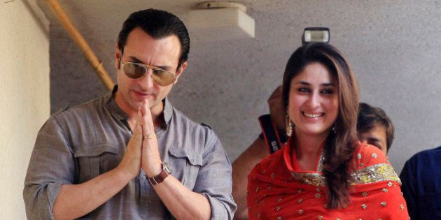 Bollywood stars, Saif Ali Khan, left, and Kareena Kapoor, step out on a balcony to greet waiting fans...
