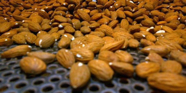 **FILE** Raw almonds are shown on a roasting tray in this file photo taken Monday, June 25, 2007 at the...
