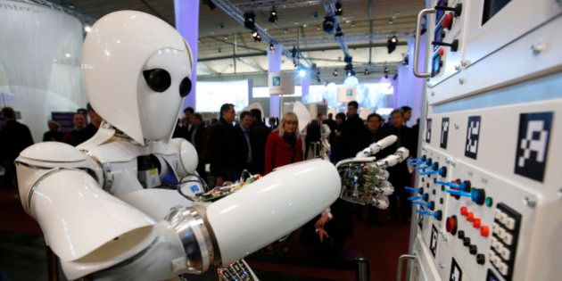 The humanoid robot AILA (artificial intelligence lightweight android) operates a switchboard during a...