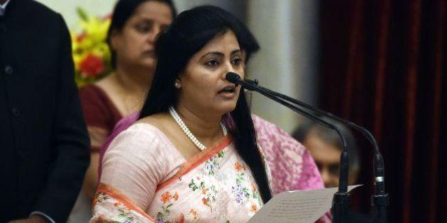 Bharatiya Janata Party (BJP) politician, Anupriya Singh Patel takes the oath during the swearing-in ceremony...