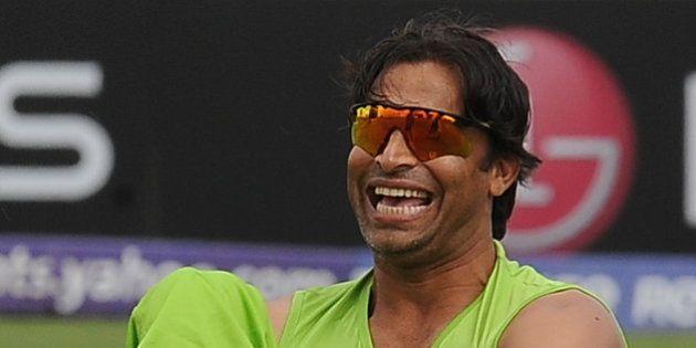 Pakistan cricketer Shoaib Akhtar laughs during a training session at The Suriyawewa Mahinda Rajapakse...