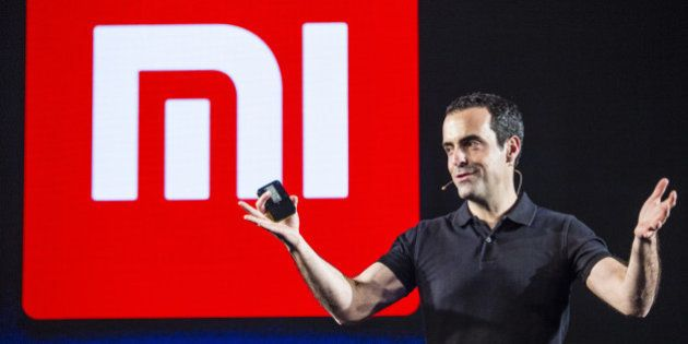 Hugo Barra, vice president of global operations at Xiaomi Corp., gestures while speaking during the launch...
