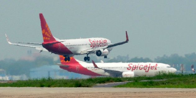 Aircraft from Spicejet jostle for space on a runway at Indira Gandhi International Airport in New Delhi...
