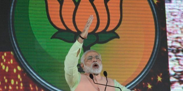 Party symbol Lotus is projected behind as India's main opposition Bharatiya Janata Party (BJP)'s prime...