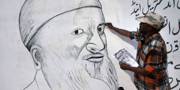 A painter makes a mural of Pakistan's greatest humanitarian worker Abdul Sattar Edhi to pay tribute to...