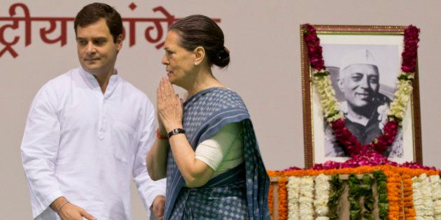 Congress party President Sonia Gandhi, right, and her son and Vice President Rahul Gandhi arrive for...