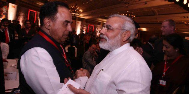 NEW DELHI, INDIA - MARCH 18: Gujarat Chief Minister Narendra Modi and Janta Dal Chief Subramanian Swamy...