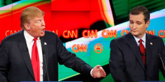Donald Trump, left, responds forcefully to Jeb Bush (not seen) as Ted Cruz looks on during the CNN Republican...