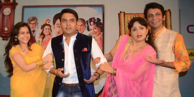 Indian comedy actor Kapil Sharma (C), Sunil Grover (R), actresses Upasana Singh (2R), and Sumona Chakravarti...