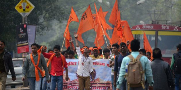 Indian Hindu activists from the Shiv Sena group march as they demand the construction of a Hindu temple...
