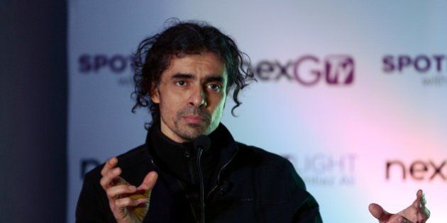 Bollywood director Imtiaz Ali gestures as he speaks during an event to launch new project 'SPOTLight'...