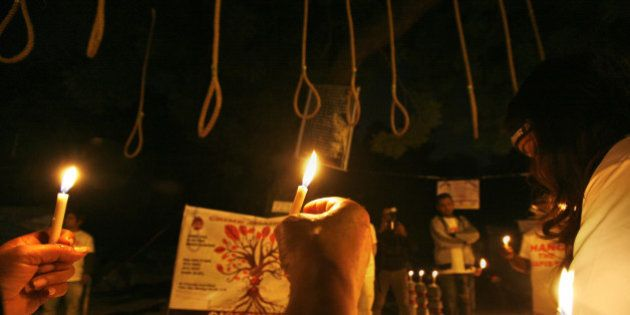 NEW DELHI, INDIA - DECEMBER 16: Indian activists hold candles near hangman's nooses during a candle light...