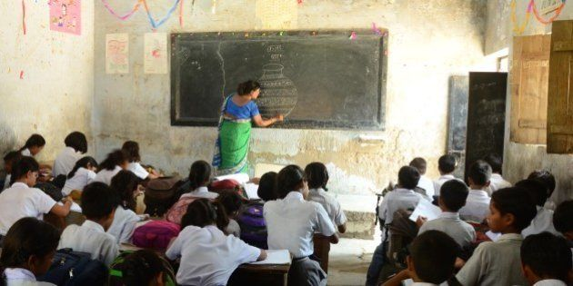 ALLAHABAD, UTTAR PRADESH, INDIA - 2015/09/08: School children attend a class at a government-run school...
