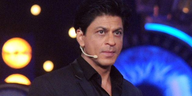 Indian Bollywood actor Shah Rukh Khan promotes his Hindi film 'Dilwale' on the set of the reality show...