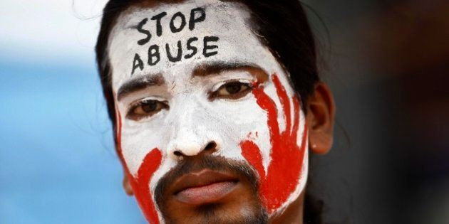 An Indian protester with a slogan painted on his face participates in a demonstration to protest against...