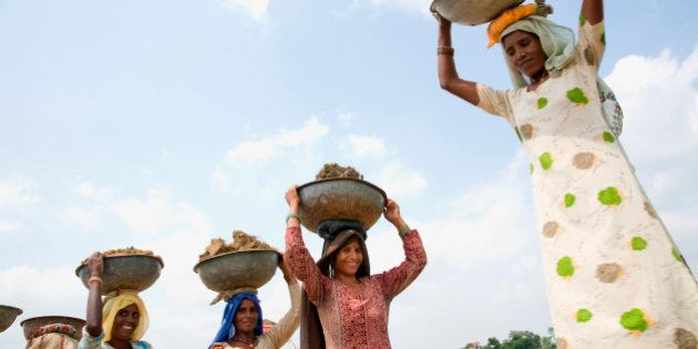 woman labours working at a construction site at Mewat near Palwal, Haryana, India. (Photo by: IndiaPictures/UIG...
