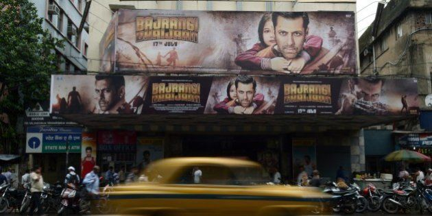 Posters for recently-released film 'Bajrangi Bhaijaan' staring Bollywood actor Salman Khan are seen in...