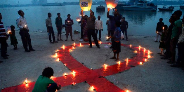KOLKATA, INDIA - 2015/12/01: Social Activists observe World AIDS Day on the bank of the River Ganges...