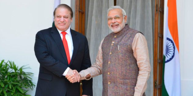 NEW DELHI, INDIA MAY 27: Pakistani Prime Minister Nawaz Sharif shakes hands with Prime Minister Narendra...