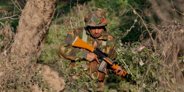 An Indian army soldier is seen during a search operation in a forest area outside the Pathankot air force...